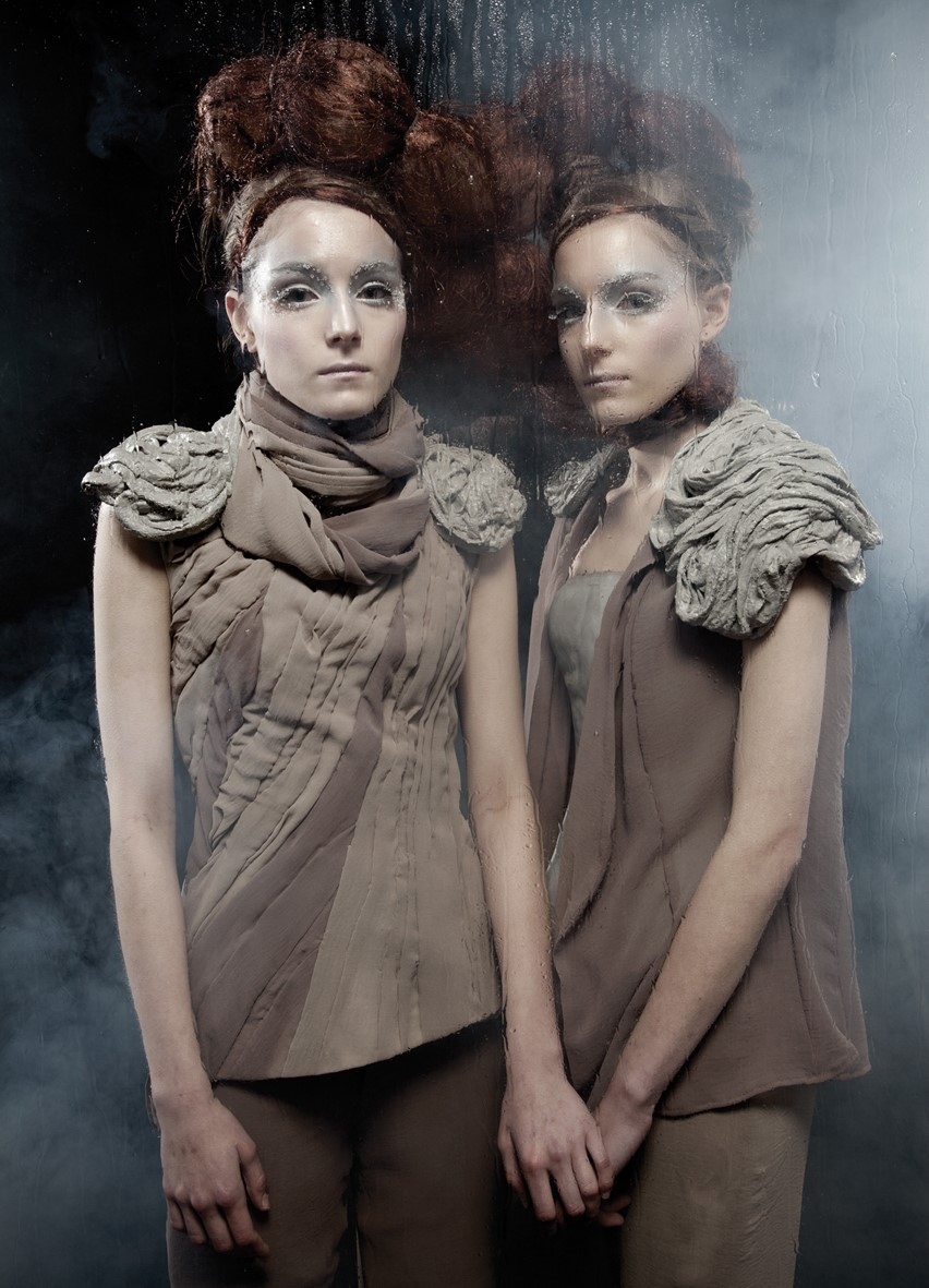 Ensembles with cement shoulder pieces by Suzaan Heyns