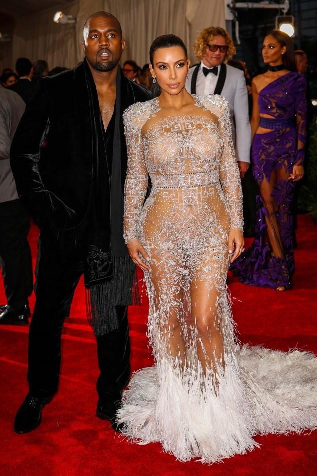 Kanye and Kim Kardashian West, both wearing Roberto Cavalli by Peter Dundas