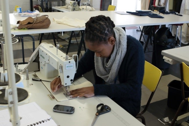 Gap Year : Students constructing garments
