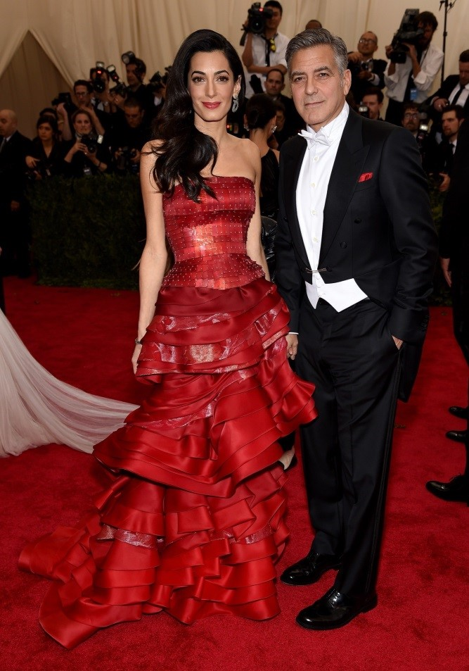 Amal Clooney, in Maison Margiela Haute Couture, Rose Byrne and Bobby Cannavale, both in and George Clooney, in Giorgio Armani
